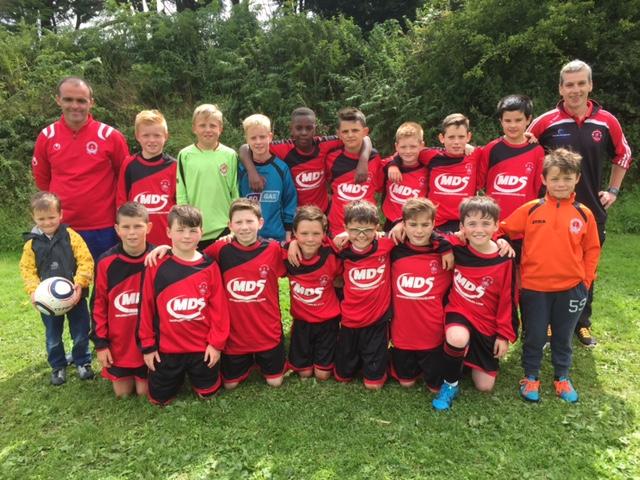 St Brendans Park Fc U12 team and Management at the Rockmount Tournament .